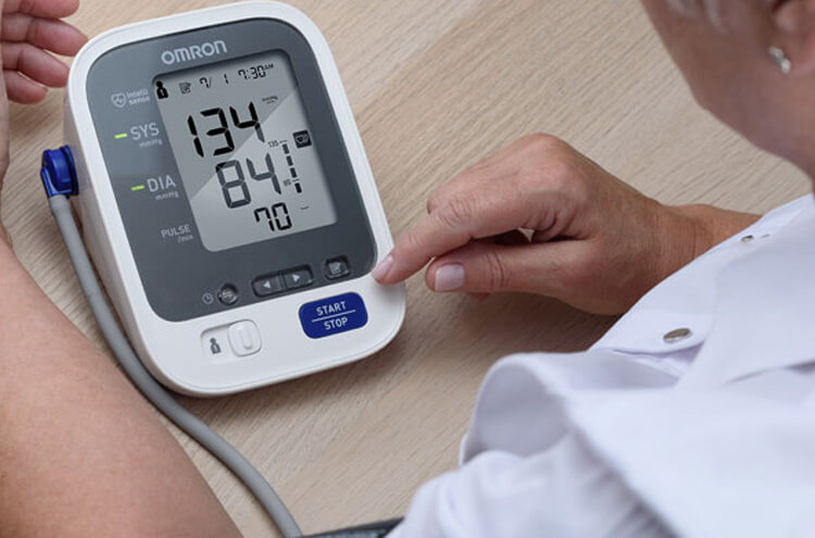 What should patients with high blood pressure do after being diagnosed with corona?