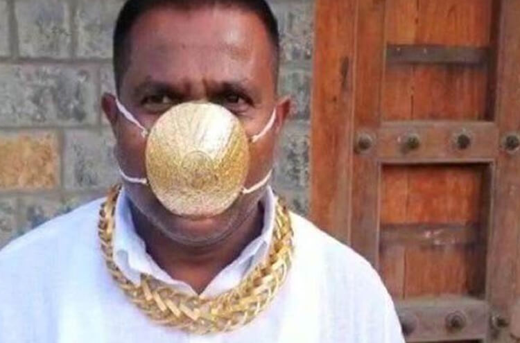 Indian man wears gold mask